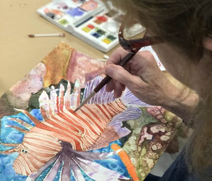 Painting with watercolor in art class