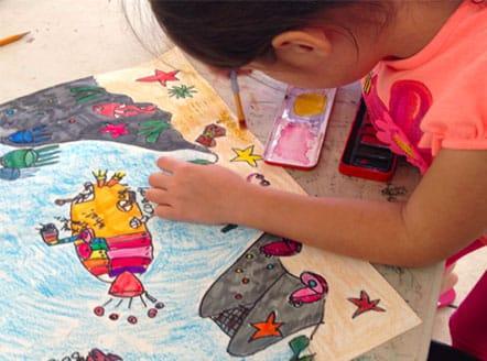 Having fun at summer art camp at ART + Academy.